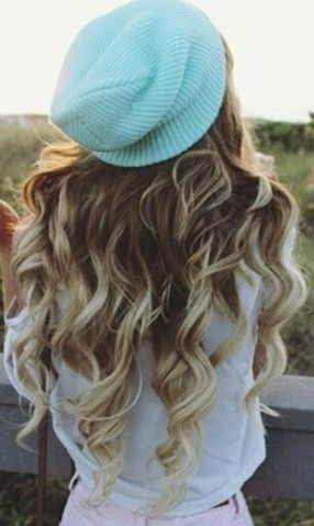 Long voluminous curls with a cute sky blue beanie is the perfect combination for a sweet and romantic look