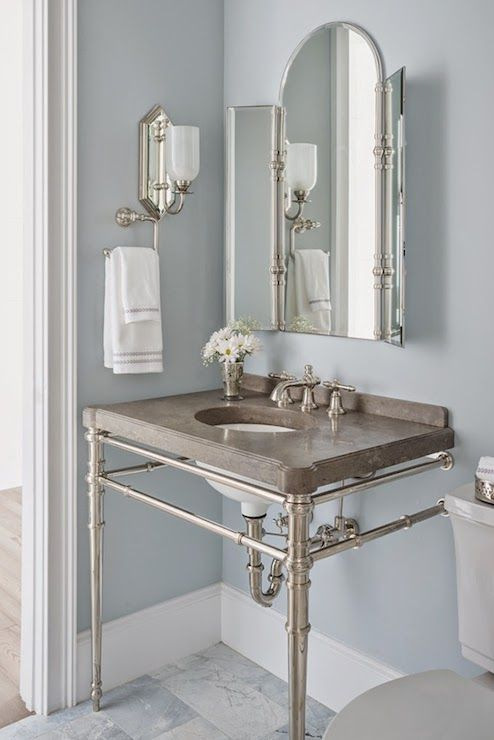 Benjamin Moore Silver Gray paint color in a luxurious bathroom with Kallista console sink - Reu Architects. #benjaminmooresilvergray #silvergray #bestbluegray #paintcolors