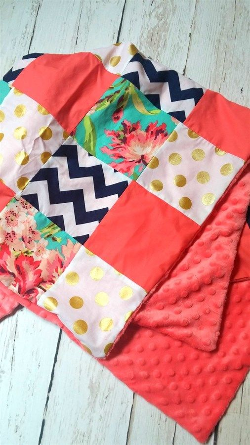 """This unique patchwork blanket is perfect for on the go, strollers/car seats, or simply for your little one to cozy up with.INCLUDES:1) On the Go Patchwork Baby Blanket   *Soft minky on back*Approx 34"""" x 32""""(Placement of fabrics will  vary with each blanket)"""