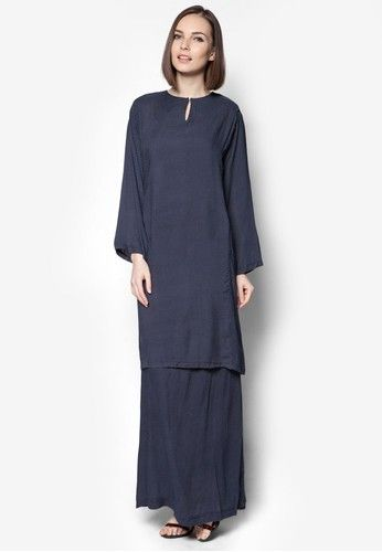 Rayon Baju Kurung from Jennifer Creations in Blue When the occasion calls for it, it is time to dress yourself in traditional wear- and might we suggest giving Jennifer Creations a try? This particular number features an irresistably cosy soft fabric that is adorned with an all-over polka dot pr... #bajukurung #bajukurungmoden