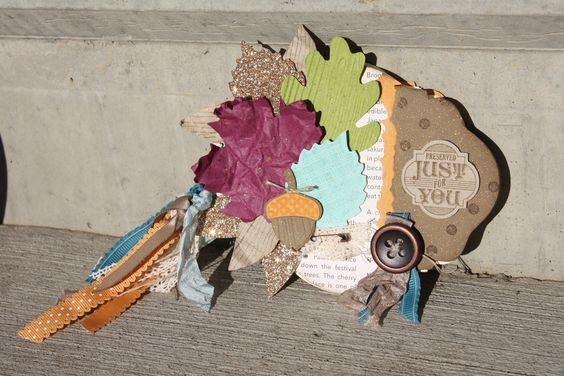 """Sarah Sagert: """"I used the Autumn Accents Bigz Die to create the leaf embellishments in a fun selection of rich playful colors.     Quick Tip: The best way to distress the 1/2"""" Seam Binding Ribbon is to ball it up in the palm of your hands and rub it together—so fast and easy!"""" http://www.facebook.com/photo.php?fbid=10151207678712512"""