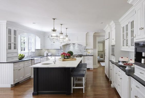 White kitchen with black beadboard island transitional for Benjamin moore white paint for kitchen cabinets
