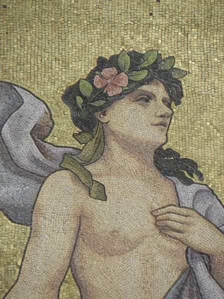Polyhymnia, the Muse of sacred music; one of the pair who presides over music, in a mosaic design from the exterior of the 1908 Salle Rameau concert hall in Lyon, France. Wikimedia Commons photo by GO69, shared under Creative Commons license, details @ http://creativecommons.org/licenses/by-sa/3.0/deed.en .