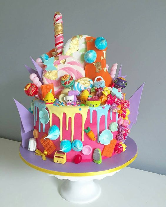 We love this Shopkins cake - Vanilla cake with bubblegum buttercream made by…: