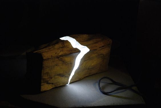 Wood and resin lamp by designer Marco Stefanelli. Light comes through the clear resin-filled rift.