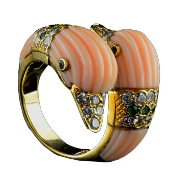VAN CLEEF & ARPELS Coral Duck Head Ring France 1969 Unusual multi-gem ring of double-head design in fluted coral each with a diamond and emerald band, diamond beaks and emerald eyes Van Cleef & Arpels, Paris