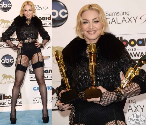 "Seriously? REALY? Now I'm convinced that she is actually-really-painstakingly-trying to be intentionally hideous! ""Madonna, 54, continues to abandon all sense of reason (and her pants) at the Billboard Awards press room on May 19, 2013. Eye roll. MAJOR eye roll. Fishnets, metallic, fur, studs, chains — seriously, what isn't going on with this outfit? And after putting on all of that crap, Madge just completely forgot to style her hair. Nice."" Well put."
