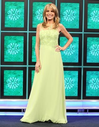 KATHY HILTON: Lime green chiffon gown w/bodice enhanced w/re-embroidered lace & aurora sequins, scoop neck upper bodice in lime illusion & re-embroidered lace, sleeveless, asymmetrical drop waist | Wheel of Fortune