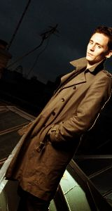 Tom Hiddleston. In that coat, you can almost imagine he's the Doctor.