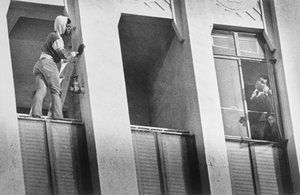 The former heavyweight champion leans out of the window on the ninth floor of a high-rise building to coax a suicidal man from jumping.