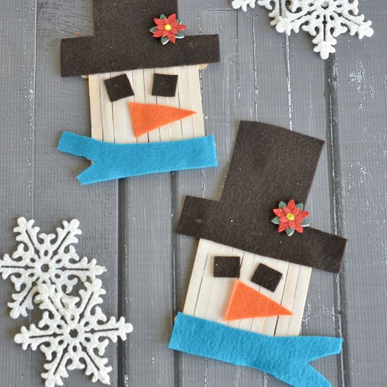 Want to build a snowman? Here's one for the kids! This Christmas snowman is made from popsicle sticks!