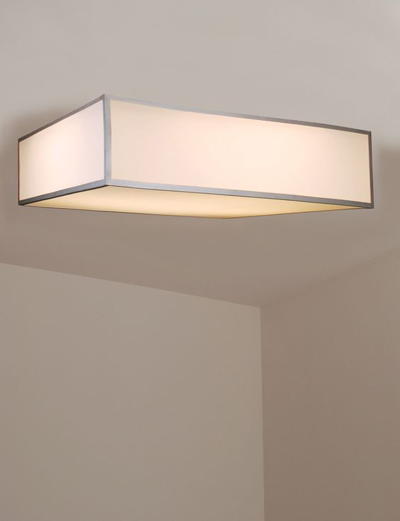 The Turo. Flush mount frosted white acrylic fixture, satin aluminum finish & fluorescent lamping & additional customization available from Lukas Lighting.