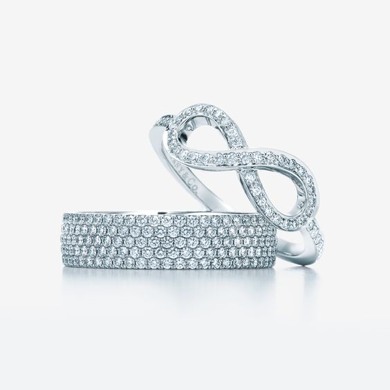 Love is infinite. From left: Tiffany Metro five-row ring in 18k white gold with diamonds and Tiffany Infinity ring in platinum with diamonds.