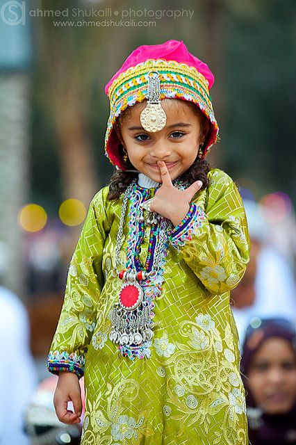 Oman | Portrait of a young girl: