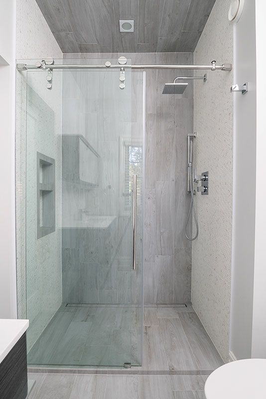 We Created A Sleek Look By Replacing The Shower Tub Combo With A Clean Glass Walk In Shower In Its Place Using Richelieu Logo Small Bathroom With Shower Bathroom Shower Tub