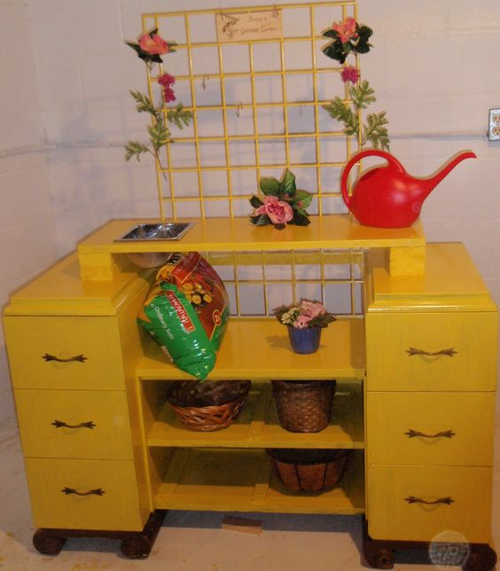 This is a homemade garden center (potting bench) with an old dresser and some scrap wood.  I also added some additional pieces laying around the garage for a personalized touch.