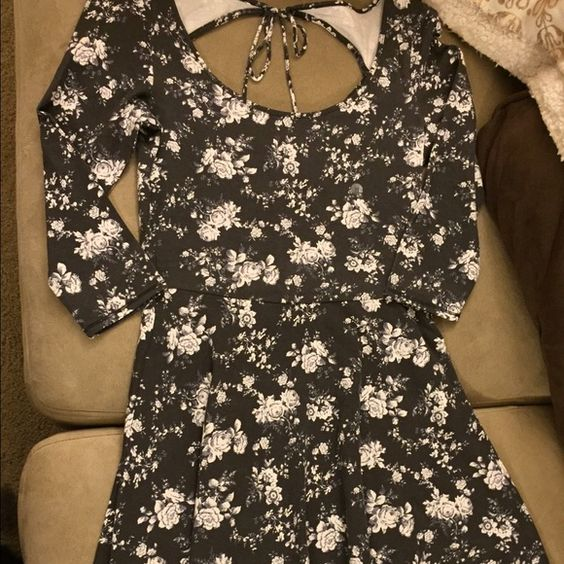 American Eagle Dress This 3/4 sleeve, open back, and A-line dress is great for any occasion! It has never been worn so it's in perfect condition. American Eagle Outfitters Dresses Mini