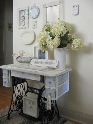vintage sewing table, perfect as an entryway table (my mom has one as her nightstand):