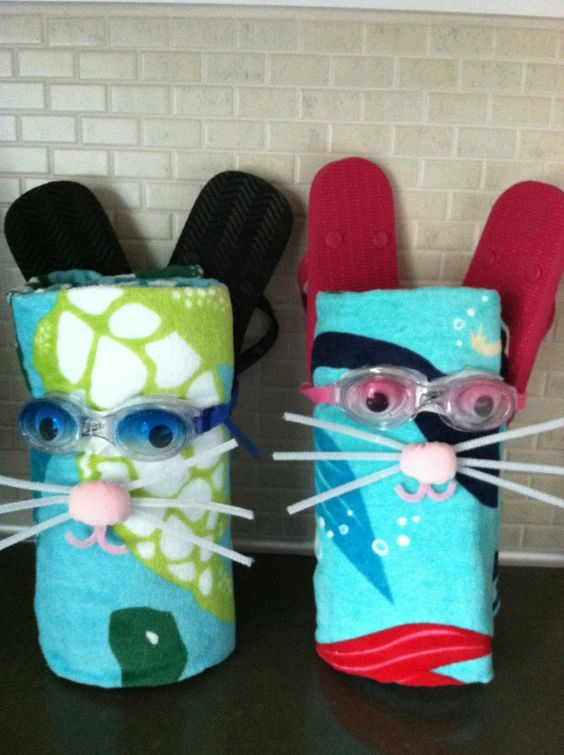Easter basket fillings - beach towel wrapped with goggles (googly eyes attached to the insert), flip flops for the ears and pompom/pipe cleaners for nose, whiskers and mouth. How cute!