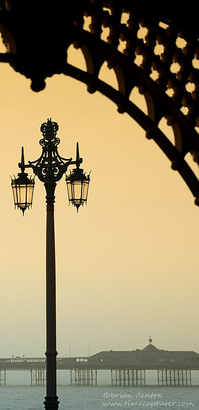 Brighton's Madeira Walk, Victorian Lamppost, and the Palace Pier in the background -  Sussex, England