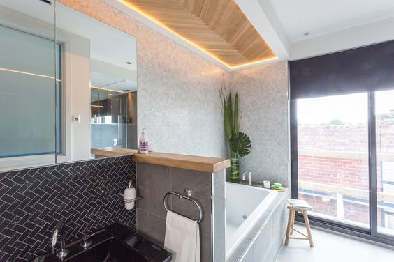 This stylish bathroom appeared on The Block Fans vs. Faves. It features our The Alpine Grigio, Herringbone Bianco Mosaic and Nero tiles from Beaumont Tiles. #TheBlock