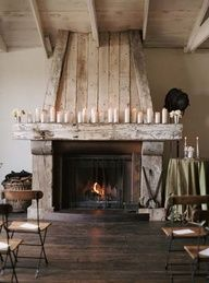 rustic fireplace and all white candles <3
