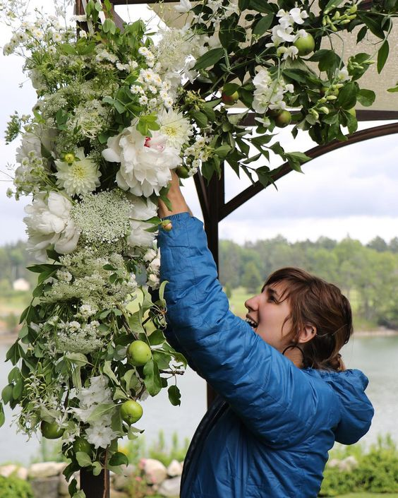 """The unstoppable @stuffeddoggie working her chuppah magic . #chickadeehillflowers #chuppah #Maine #wedding"""