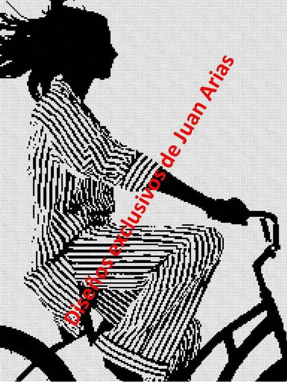 En bicicleta a rayas en punto cruz