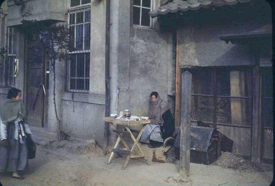 Money vendor, 1949 Seoul. Photo is lightened from original (link).