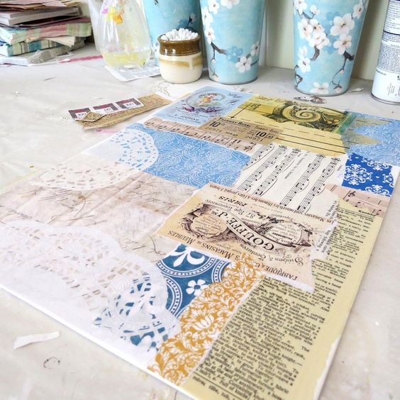 First layer of papers for a background. Art in progress - mixed media using vintage papers and sheet music.: