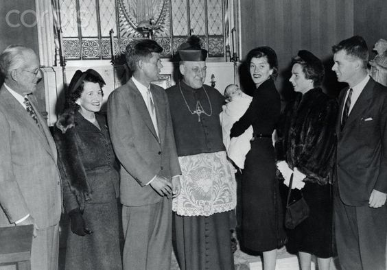 Archbishop Richard J. Cushing at his Brighton residence baptized Joseph P. Kennedy II, son of Mrs. and Mr. Robert Kennedy. John F. Kennedy is the godfather. Date Photographed:20 October 1952