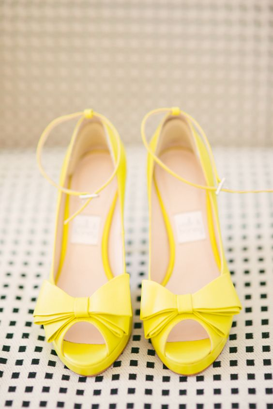Cute little yellow peep toes with bows! Photo by Honey Honey Photography. www.wedsociety.com #yellow #shoes