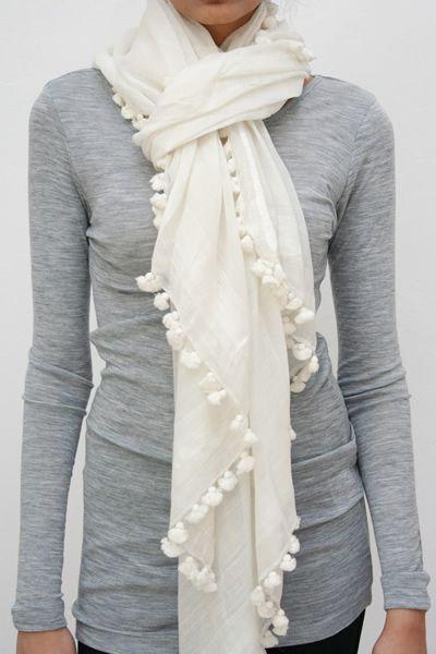 cute scarf! I am wondering if I can sew cute pom poms onto a linen scarf that I already own...hmmm