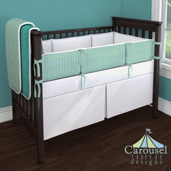 Crib bedding in Solid Antique White, Solid Emerald Turquoise, Mint Herringbone, White Pimatex. Created using the Nursery Designer® by Carousel Designs where you mix and match from hundreds of fabrics to create your own unique baby bedding. #carouseldesigns