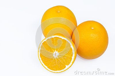 Fresh Oranges with slices on white background.