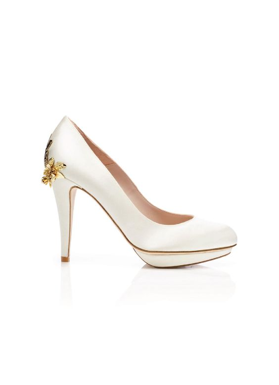 These gorgeous wedding shoes are designed in London by Harriet Wilde. A stylish high heel round-toe pump, ...