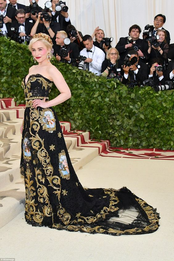 Glittering goddess: Game Of Thrones' Emilia Clarke chose a stunning black and gold dress w... #metgala #emiliaclarke