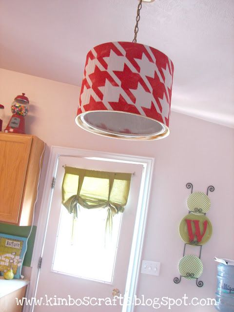 diy drum shade -- cheap, easy & perfect to put over the ugly, standard hanging light in my kitchen. Maybe in a different color or pattern though...