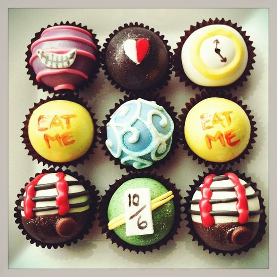 cake balls by the cake ballers. Alice in Wonderland complete with Tweedle Dee & Tweedle Dum, the White Rabbit, the Red Queen, the Mad Hatter and the Cheshire Cat. www.thecakeballers.com info@thecakeballers.com #thecakeballers #cakeballers #cakeballer #cakeballs #cakeball #cake #ball #downtherabbithole #aliceinwonderland #imagination #madhatter #redqueen #whiterabbit #eatme #idahoballers
