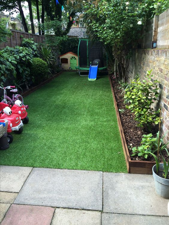 Artificial lawn supplied by http://www.everlawn.co.uk following their D.I.Y manual. Great results and child & pet friendly.