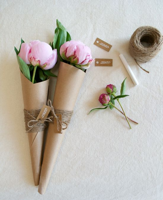 DIY MOTHER'S DAY BOUQUET. You Need: Flowers, Kraft paper, Baker's twine or string, Gift tags, Ziploc bags, Paper towels, Scissors, Clear tape. Roll a sheet of Kraft paper into a cone shape. Wrap Kraft paper cone with twine. Add gift tag to one end of the twine. Tie ends together to make a bow. Prep flowers by cutting them down to the proper size. Wet a sheet of paper towel, wrap it around the end of the flower, and place it into a Ziploc bag. Repeat with each flower.