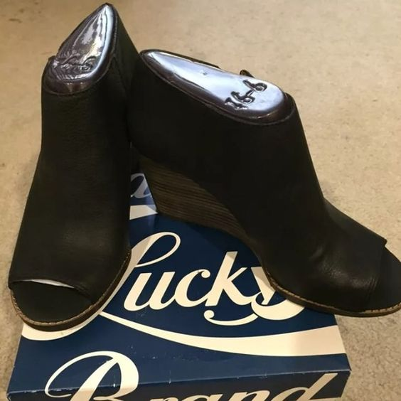 Lucky Brand open toe bootie Super comfy open toe wedge bootie! Sz 9.5 new in box. Price is firm, please don't insult me! Thanks Lucky Brand Shoes