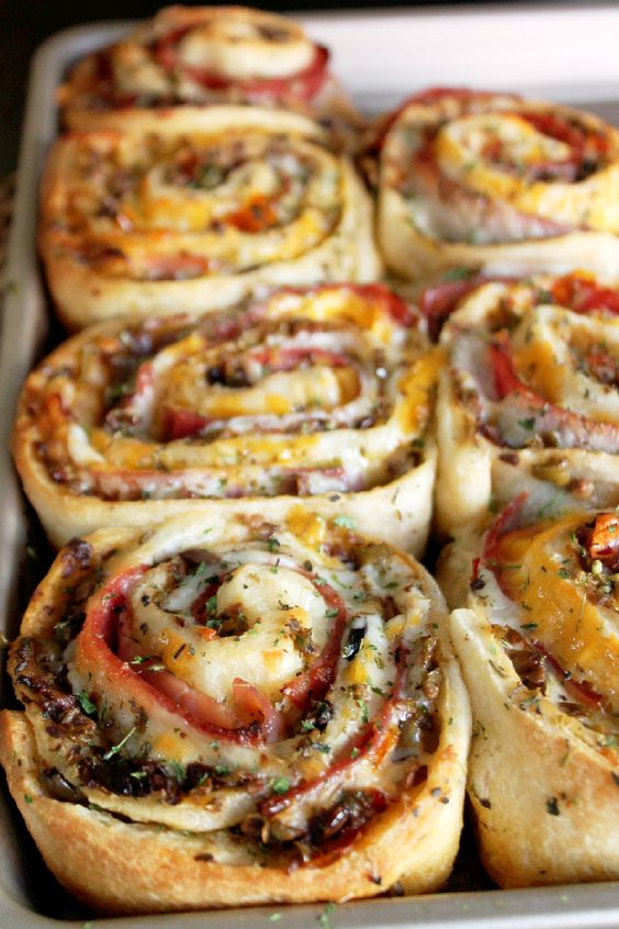 http://creolecontessa.com/2015/11/muffuletta-pizza-rolls/