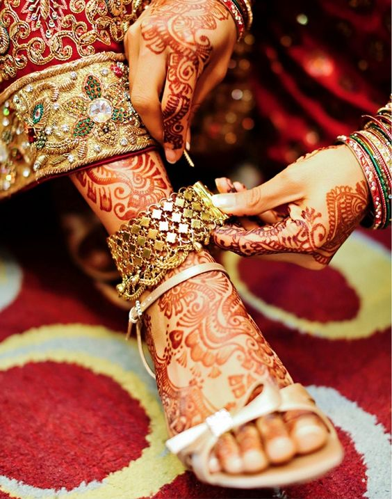 The Indian traditional bride. The mehndi designs are absolutely stunning.