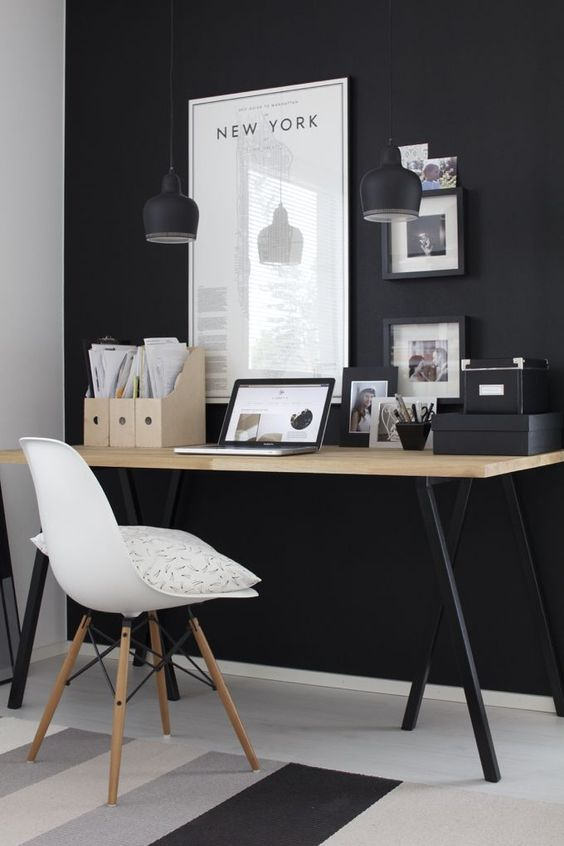 There's something so elegant about a black accent wall. Still afraid to try it as a bedroom color, but perhaps for a home office? -VV gravity-gravity:  Source