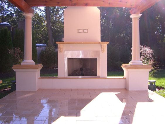 Stainless steel fireplace,stucco finish,fiberglass columns,limestone patio,cedar pergola