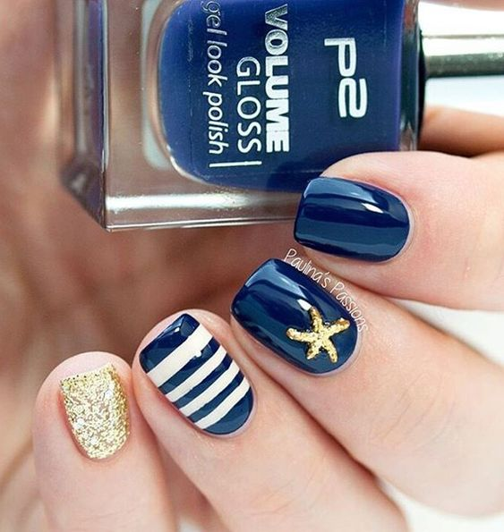 Blue, gold and white winter nail art combination. Design your nails in cute white stripes and golden colored starfish plus a glitter full of pinky nails. Source