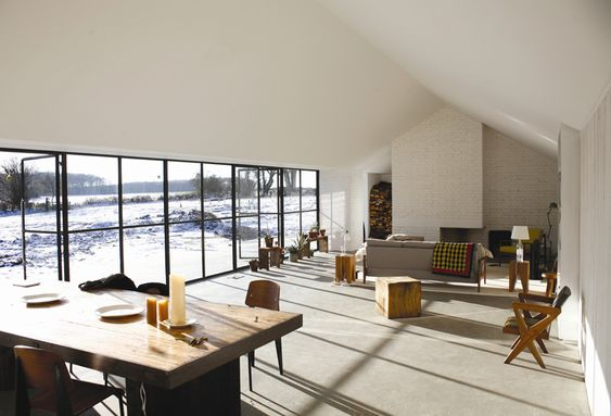 Big windows, lots of bright sunshine, concrete floors (by David Kohn Architects)