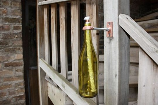 Wine Bottle Torch maybe put it in a bucket of sand