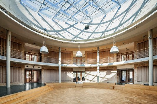 In the center of the building is a circular atrium as a meeting place and communication
